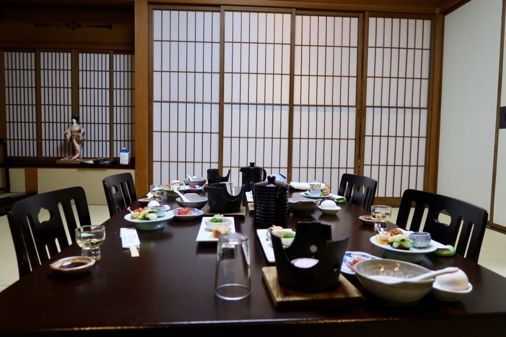 Ryokan room with the start of dinner service