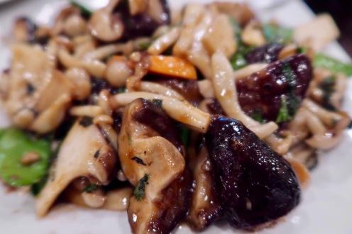Three mushrooms with basil
