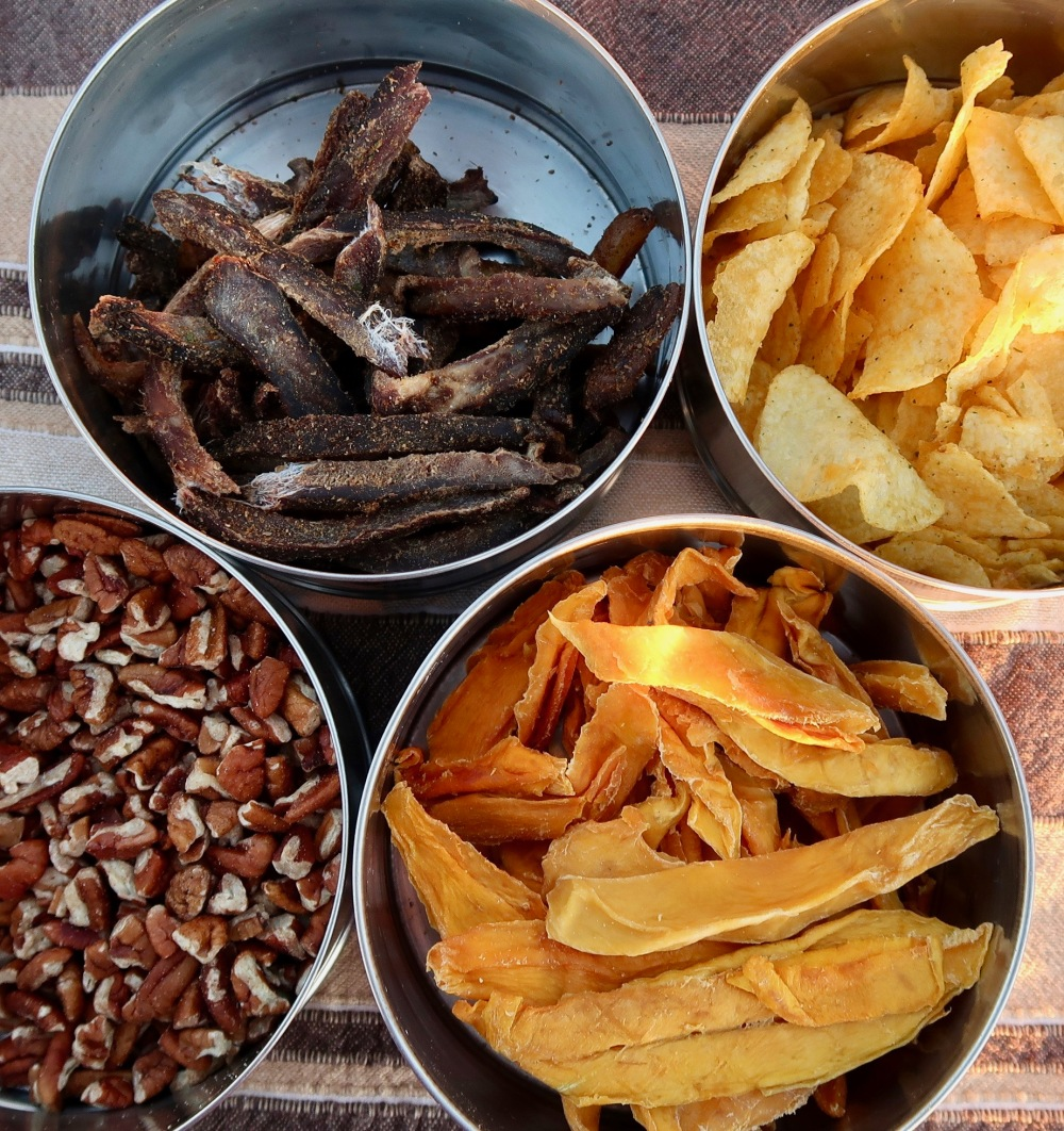 Sundowner snacks - biltong, crisps, pecan nuts and dried mango.